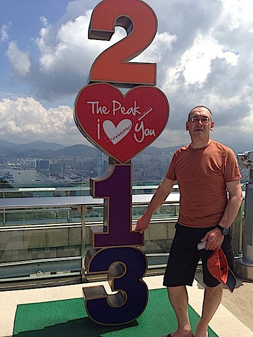image of me standing next to a sign that makes the year 2013 with numbers stacked on top o each other. The zero is a heart which says The Peak, I Love you