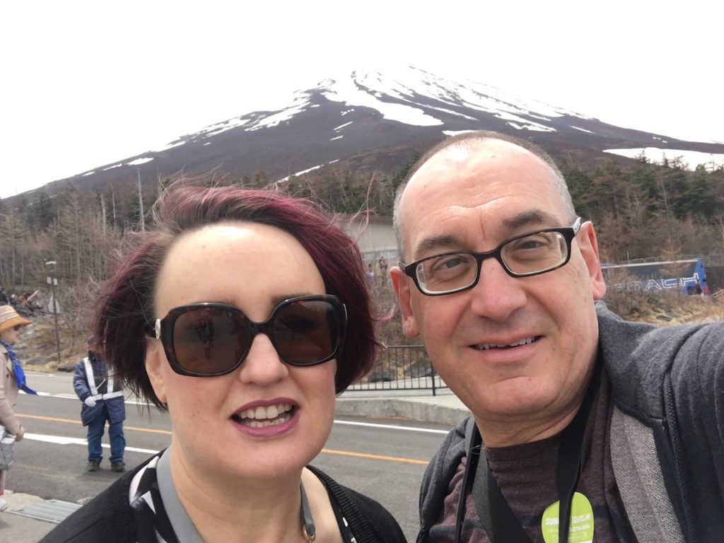 Mardi and I in front of Mouth Fuji. The mountain is covered in snow near its peak.