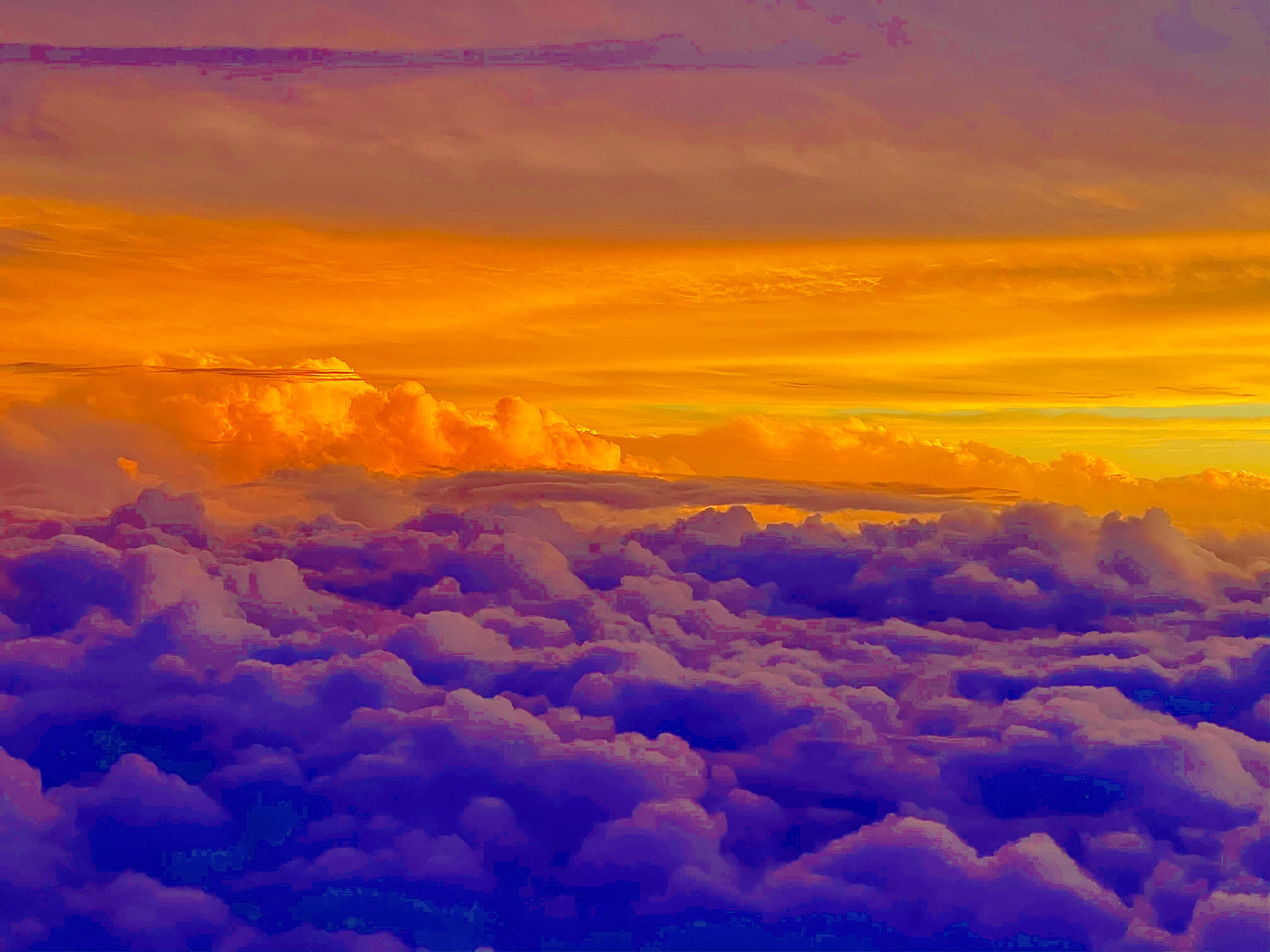 Image o clouds taken form aircraft, sunset